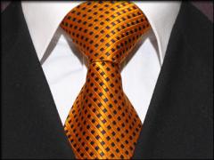 Handvernähte Krawatte aus Seide orange schwarz kariert
