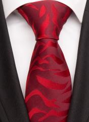 Handvernähte Krawatte aus Seide in rot, changierend gemustert