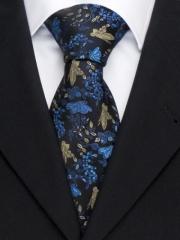 Handvernähte Krawatte aus Seide auf schwarz in bronzenem und blauen Muster